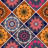 Seamless diagonal patchwork pattern in boho style with flower - mandalas. Print for fabric, paper, wallpaper, packaging design Royalty Free Stock Image