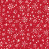 Seamless different snowflakes pattern. Seamless different snowflakes on red background Royalty Free Stock Image