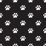 Seamless dog paw pattern on black Royalty Free Stock Photo