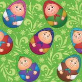 Seamless, dolls and floral pattern. Seamless background, Russian traditional national wooden dolls Matreshka in the form of Easter eggs and green floral pattern Royalty Free Stock Image