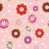 Seamless donuts pattern with pink background vector design Royalty Free Stock Photography