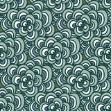 Seamless doodle. Simple floral pattern in winter blue-green tones. Stock Images
