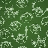 Seamless doodle smiling kids faces on chalkboard Royalty Free Stock Images