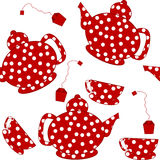 Seamless with dotted kettles, tea cups and tea bags Royalty Free Stock Image