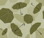 A seamless drawing umbrellas. Olive-green umbrellas seamless background pattern Royalty Free Stock Photo