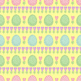 Seamless Easter pattern, card. Vector background with Easter eggs, spring flowers and hearts. Royalty Free Stock Photo