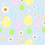 Seamless easter pattern with painted eggs, chamomile flowers and dots. Seamless easter pattern with colored and painted eggs, chamomile flowers and dots on blue Stock Photo