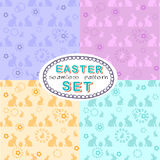 Seamless Easter pattern set with four patterns with eggs and rabbits Royalty Free Stock Image
