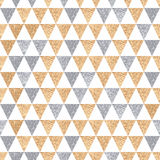 Seamless ethnic background simple triangles. Golden and silver. Seamless ethnic background simple triangles. Golden and silver geometric shapes on a white Stock Image