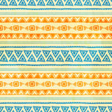 Seamless ethnic background. Vintage vector illustration. Orange and blue stripes. Drawing by hand Stock Images