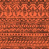 Seamless ethnic grunge background. Geometric pattern. Handmade. Tribal motifs. Black elements on an orange background in grunge style. Vintage vector Royalty Free Stock Photography