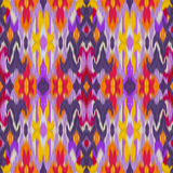 Seamless ethnic intricate ikat pattern background Stock Photography