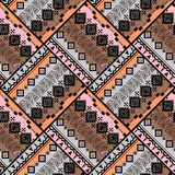 Seamless ethnic patchwork pattern. Black, orange, pink, brown background. Stylish pattern Royalty Free Stock Photo