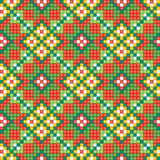 Seamless ethnic pattern background in green, orang Royalty Free Stock Image