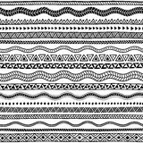 Seamless ethnic pattern. Black and white geometric ornament. Cut. E wavy stripes. Vector illustration drawn by hand Royalty Free Stock Photos