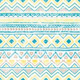 Seamless ethnic pattern. Vintage geometric ornament. Grunge text. Ure. White, blue and yellow colors. Handmade. Bohemian print for textiles. Vector illustration Royalty Free Stock Photo