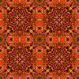 Seamless ethnic pattern in warm tones with red flowers on abstract geometric background. Vector illustration. Print for fabric, wrapping design, greeting card Royalty Free Stock Photography