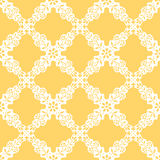 Vector seamless Ethnic pattern with white flowers on yellow background. Royalty Free Stock Images
