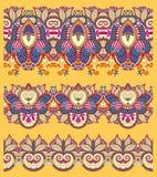 Seamless ethnic yellow paisley stripe pattern Stock Photos