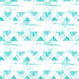 Seamless ethnic zigzag pattern with brushstrokes. Vector seamless ethnic zigzag pattern with bold brushstrokes and stripes in bright aqua blue color can be used Stock Images
