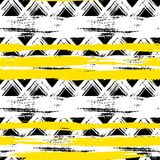 Seamless ethnic zigzag pattern with brushstrokes. Vector seamless ethnic pattern with bold zigzag brushstrokes and stripes in bright colors can be used for print Royalty Free Stock Image