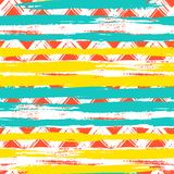 Seamless ethnic zigzag pattern with brushstrokes. Vector seamless ethnic pattern with bold zigzag brushstrokes and stripes in bright colors can be used for print Royalty Free Stock Images