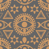 Seamless Evil Eye Pattern. A seamless evil eye pattern in gold and grey with geometric icons Stock Photography