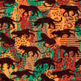 Seamless exotic pattern with abstract silhouettes of animals. Stock Photos