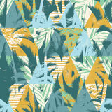 Seamless exotic pattern with palm leaves on geometric background Royalty Free Stock Photo