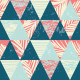 Seamless exotic pattern with palm leaves on geometric background Stock Images