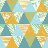 Seamless exotic pattern with palm leaves on geometric background Stock Photo