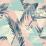 Seamless exotic pattern with palm leaves on geometric background Royalty Free Stock Images