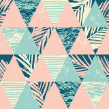 Seamless exotic pattern with palm leaves on geometric background Royalty Free Stock Photography