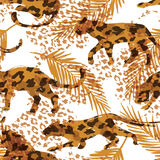 Seamless exotic pattern with palm leaves and silhouettes of animals Royalty Free Stock Photos