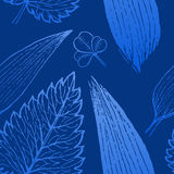 Seamless exotic pattern with tropical leaves on a white background. Royalty Free Stock Photos