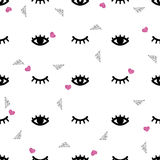 Seamless eye and eyelash with glitter pattern background. Seamless black eye and eyelash with glitter on white pattern background Royalty Free Stock Images