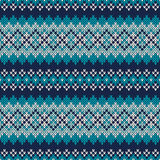 Seamless Fair Isle Knitted Pattern. Festive and Fashionable Swea. Seamless pattern ornament on the wool knitted texture. EPS available Royalty Free Stock Photo