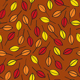 Seamless Fall Leaves. A seamless pattern of fall leaves done in traditional fall or autumn colors on a brown background Royalty Free Stock Photos