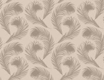 Seamless feather pattern. Beige-colored background with feathers of bird. Stock Photos