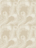Seamless feather pattern. Beige-colored background with feathers of peacock. Royalty Free Stock Image