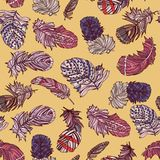 Seamless feather pattern. Seamless pattern with hand drawn feathers on yellow background. Vector illustration Stock Photo