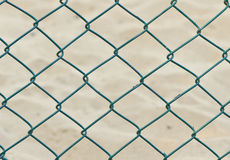 Seamless fence chain on sand background Stock Photography