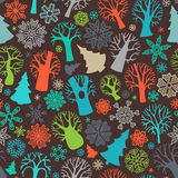 Seamless festive colorful forest pattern. Bright deciduous trees and firs, snowflakes on dark background. Boundless texture can be used for web page backgrounds Stock Image