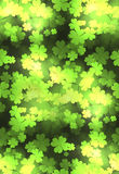 Seamless festive texture with a happy four-leaf clover. Sparks and blurred bokeh. Vector pattern for your creativity Royalty Free Stock Photos