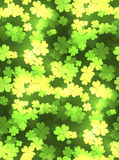 Seamless festive texture with a happy four-leaf clover Royalty Free Stock Photos