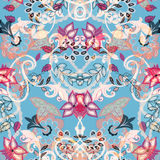 Seamless floral background. Abstract paisley style flowers on bl Royalty Free Stock Photos