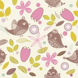 Seamless floral background with birds in vector Stock Images
