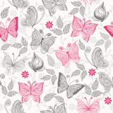 Seamless floral background with butterflies Stock Images