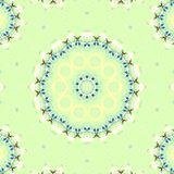 Seamless floral circle ornament pastels green. Abstract geometric seamless background. Regular symmetric floral circle ornaments in pastel colors yellow, white Royalty Free Stock Image