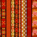 Seamless floral and geomentric elements lace pattern on red back Stock Photos